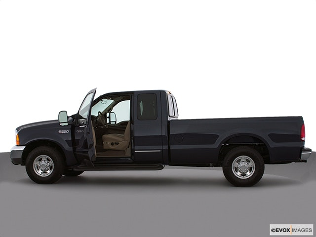 2000 Ford F-250 Super Duty Driver's side profile with drivers side door open