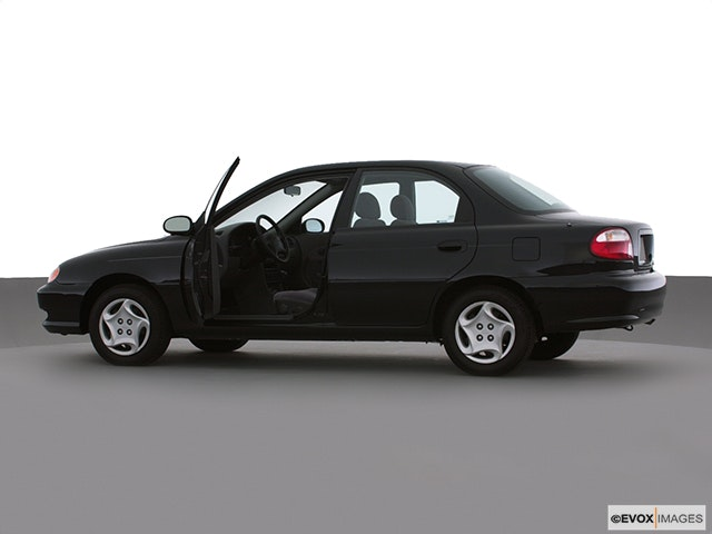 2000 Kia Sephia Driver's side profile with drivers side door open