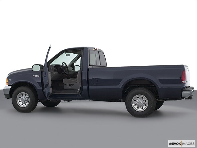2001 Ford F-250 Super Duty Driver's side profile with drivers side door open
