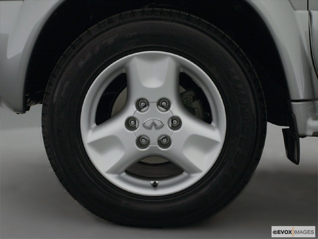 2001 INFINITI QX4 Front Drivers side wheel at profile
