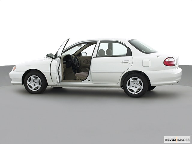 2001 Kia Sephia Driver's side profile with drivers side door open