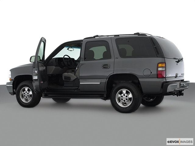 2003 Chevrolet Tahoe Driver's side profile with drivers side door open