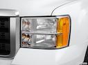 2012 GMC Sierra 2500HD Drivers Side Headlight