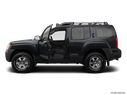 2012 Nissan Xterra Driver's side profile with drivers side door open